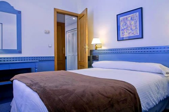 Gran via 65 apart hotel cheap vacations packages red tag for Madrid appart hotel